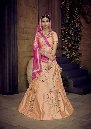 Look Pretty In This Designer Peach Colored Lehenga Choli Paired With Contrasting Rani Pink Colored Dupatta. It Is Satin Silk Based Beautified With Attractive Embroidery Paired With Net Fabricated Dupatta.  Buy Now.