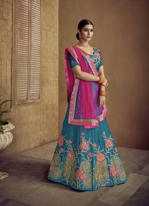 Grab This Designer Rich Looking Lehenga Choli In Blue Color Paired With Contrasting Dark Pink Colored Dupatta. Its Blouse And Lehenga Are Fabricated On Satin Silk Paired With Net Fabricated Dupatta. Buy Now.