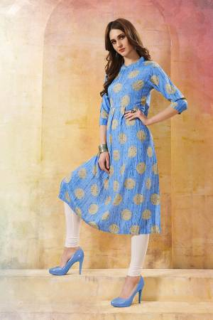 For your Casual Wear, Grab This Readymade Kurti In Sky Blue Color Fabricated On Rayon. This Kurti Is Beautified With Prints And Also It IS Light In Weight.