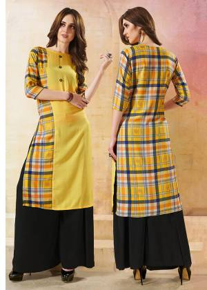 Grab This Checkered Readymade Kurti In Yellow Color Fabricated On Rayon. This Kurti Is Beautified With Checks Prints Over The Back And Half Front.