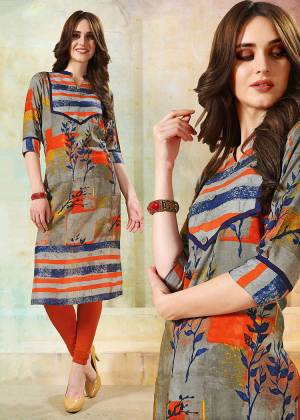 Go Colorful With This Multi Colored Readymade Kurti Fabricated On Rayon. This Kurti Is Beautified With Abstract Prints.