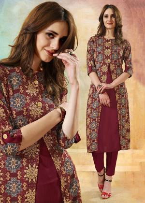 New Patterned Readymade Kurti Is Here In Maroon Color Fabricated On Rayon. This Kurti Is Beautified With Pretty Prints And It IS Easy To Carry All Day Long.