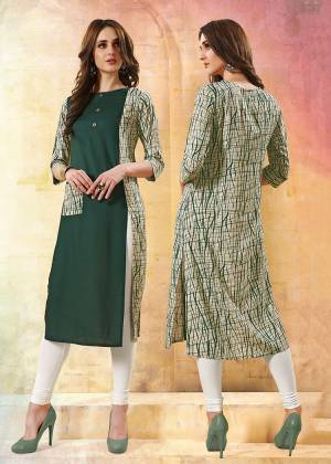 Formal Looking Readymade Kurti Is Here In Dark Green And White Color. This Kurti Is Fabricated On Rayon Beautified With Prints.