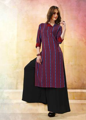 Go Colorful With This Multi Colored Readymade Kurti Fabricated On Rayon. This Kurti Is Beautified With Intricate Prints.