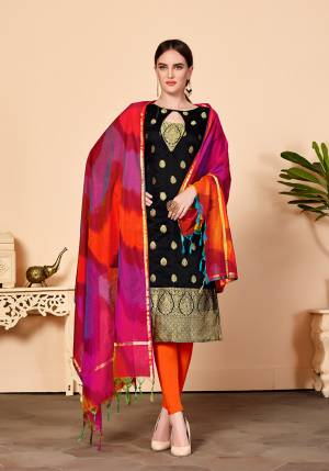 For Your Caasuals Or Semi-Casuals, Grab This Pretty Dress Material In Black Colored Top Paired With Orange Colored Bottom And Multi Colored Dupatta. Its Top Is Fabricated On Jacquard Silk Paired With Cotton Fabricated Bottom And Banarasi Art Silk Dupatta. Buy Now.