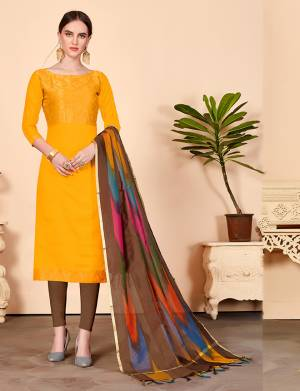 Shine Bright Wearing This Suit In Musturd Yellow Colored Top Paired With Contrasting Brown Colored Bottom And Multi Colored Dupatta. Its Top Is Fabricated On Jacquard Silk Paired With Cotton Bottom And Banarasi Art Silk Dupatta. Get This Stitched As PerYour Desired Fit And Comfort.