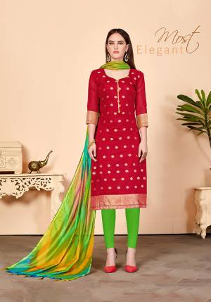 Proper Traditional Color Pallete Is Here With This Designer Dress Material In Red Colored Top Paired With Contrasting Green Colored Bottom And Dupatta. Its Top And Dupatta are Silk Based Paired With Cotton Fabricated Bottom.