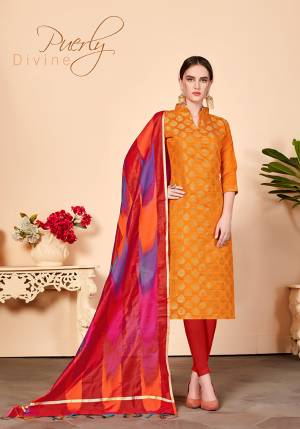 For Your Caasuals Or Semi-Casuals, Grab This Pretty Dress Material In Orange Colored Top Paired With Contrasting Red Colored Bottom And Dupatta. Its Top Is Fabricated On Jacquard Silk Paired With Cotton Fabricated Bottom And Banarasi Art Silk Dupatta. Buy Now.
