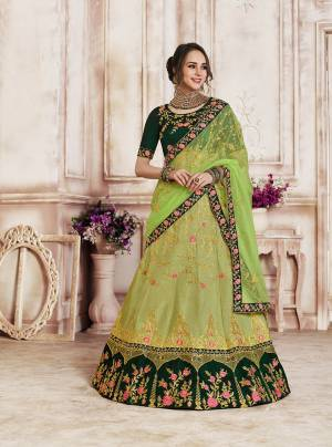 Go With The Shades Of Fresh Green Colors With This Heavy Designer Lehenga Choli In Dark Green Colored Blouse Paired With Light Green Colored Bottom And Dupatta. Its Blouse And Lehenga Are Fabricated On Art Silk Paired With Net Fabricated Dupatta.