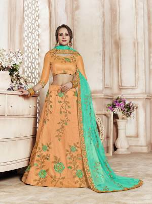 Catch All The Limelight Wearing This Heavy Designer Lehenga Choli In Peach Color Paired With Contrasting Sea Green Colored Dupatta. Its Blouse And Lehenga Are Silk Based Paired With Net Fabricated Dupatta. Its Rich Fabric And Color Pallete Will Earn You Lots Of Compliments From Onlookers.