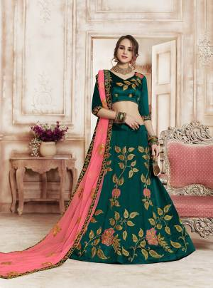 New And Unique Color Pallete Is Here With This Heavy Designer Lehenga Choli In Teal Blue Color Paired With Contrasting Pink Colored Dupatta. Its Contrasting Embroidery Will Give An Attractive Look.