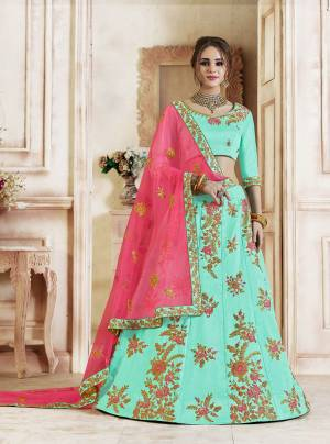 Look Pretty In This Lovely Shades Wearing This Heavy Designer Lehenga Choli In Aqua Blue Color Paired With Contrasting Rani Pink Colored Dupatta. This Lehenga Choli Is Silk Based Paired With Net Fabricated Dupatta. Buy Now.
