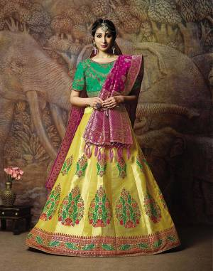 Attract All Wearing This Heavy Designer Lehenga Choli In Green Colored Blouse Paired With Yellow Colored Lehenga And Dark Pink Colored Dupatta. This Silk Based Lehenga Choli Is Beautified With Heavy Weave And Subtle Embroidery. Its Lehenga And Dupatta Are Fabricated On Jacquard Silk Paired With Art Silk Fabricated Blouse. Buy Now.