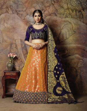 Catch All The Limelight In The Next Wedding You Attend With This Designer Lehenga Choli In Navy Blue Colored Blouse Paired With Contrasting Orange Colored Lehenga And Navy Blue Colored Dupatta. Its Lehenga Are Dupatta Are Fabricated On Jacquard Silk PAired With Art Silk Fabricated Blouse.