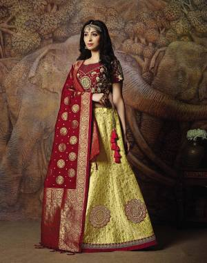 Attract All Wearing This Heavy Designer Lehenga Choli In Maroon Colored Blouse Paired With Yellow Colored Lehenga And Maroon Colored Dupatta. This Silk Based Lehenga Choli Is Beautified With Heavy Weave And Subtle Embroidery. Its Lehenga And Dupatta Are Fabricated On Jacquard Silk Paired With Art Silk Fabricated Blouse. Buy Now.
