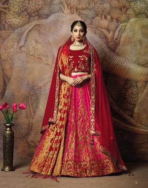 Adorn A Proper Traditional Look Wearing This Heavy Designer Lehenga Choli In Maroon Colored Blouse Paired With Dark Pink Colored Lehenga And Maroon Colored Dupatta. This Lehenga And Blouse Are Fabricated On Jacquard Silk Paired With Brocade Fabricated Blouse.
