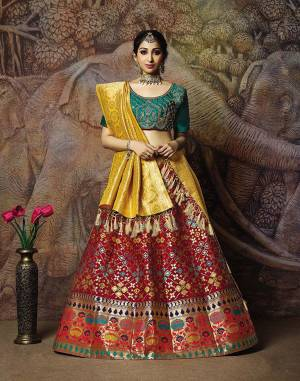 You Will Definitely Earn Lots Of Compliments In This Rich Silk Based Designer Lehenga Choli. Its Blouse Is In Teal Green Color Paired With Maroon Colored Lehenga And Yellow Colored Dupatta. It Is Beautified With Bold Weave And Subtle Embroidery Over The Blouse. Buy This Silk Based Lehenga Choli Now.