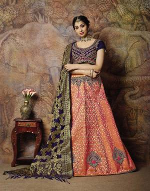 Attract All Wearing This Heavy Designer Lehenga Choli In Violet Colored Blouse Paired With Dark Peach Colored Lehenga And Violet Colored Dupatta. This Silk Based Lehenga Choli Is Beautified With Heavy Weave And Subtle Embroidery. Its Lehenga And Dupatta Are Fabricated On Jacquard Silk Paired With Art Silk Fabricated Blouse. Buy Now.