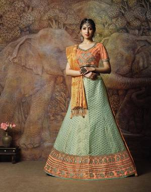Catch All The Limelight In The Next Wedding You Attend With This Designer Lehenga Choli In Orange Colored Blouse Paired With Contrasting Aqua Blue Colored Lehenga And Golden & Orange Colored Dupatta. Its Lehenga Are Dupatta Are Fabricated On Jacquard Silk PAired With Art Silk Fabricated Blouse.