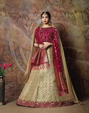 You Will Definitely Earn Lots Of Compliments In This Rich Silk Based Designer Lehenga Choli. Its Blouse Is In Magenta Pink Color Paired With Cream Colored Lehenga And Magenta Pink Colored Dupatta. It Is Beautified With Bold Weave And Subtle Embroidery Over The Blouse. Buy This Silk Based Lehenga Choli Now.