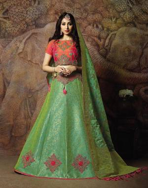 Attract All Wearing This Heavy Designer Lehenga Choli In Orange Colored Blouse Paired With Green Colored Lehenga And Green Colored Dupatta. This Silk Based Lehenga Choli Is Beautified With Heavy Weave And Subtle Embroidery. Its Lehenga And Dupatta Are Fabricated On Jacquard Silk Paired With Art Silk Fabricated Blouse. Buy Now.