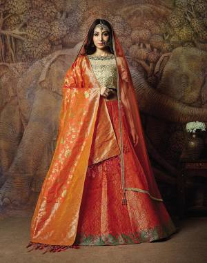 Catch All The Limelight In The Next Wedding You Attend With This Designer Lehenga Choli In Cream Colored Blouse Paired With Contrasting Orange Colored Lehenga And Orange Colored Dupatta. Its Lehenga Are Dupatta Are Fabricated On Jacquard Silk PAired With Art Silk Fabricated Blouse.