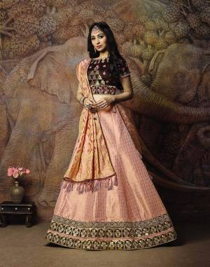 Adorn A Proper Traditional Look Wearing This Heavy Designer Lehenga Choli In Brown Colored Blouse Paired With Baby Pink Colored Lehenga And Baby Pink Colored Dupatta. This Lehenga And Blouse Are Fabricated On Jacquard Silk Paired With Brocade Fabricated Blouse.