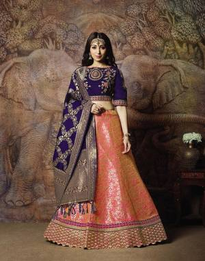 Attract All Wearing This Heavy Designer Lehenga Choli In Violet Colored Blouse Paired With Pink Colored Lehenga And Violet Colored Dupatta. This Silk Based Lehenga Choli Is Beautified With Heavy Weave And Subtle Embroidery. Its Lehenga And Dupatta Are Fabricated On Jacquard Silk Paired With Art Silk Fabricated Blouse. Buy Now.