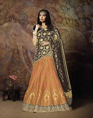 Catch All The Limelight In The Next Wedding You Attend With This Designer Lehenga Choli In Navy Blue Colored Blouse Paired With Contrasting Peach Colored Lehenga And Navy Blue Colored Dupatta. Its Lehenga Are Dupatta Are Fabricated On Jacquard Silk PAired With Art Silk Fabricated Blouse.
