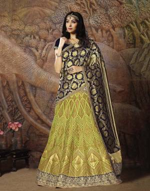 Adorn A Proper Traditional Look Wearing This Heavy Designer Lehenga Choli In Navy Blue Colored Blouse Paired With Light Green Colored Lehenga And Navy Blue Colored Dupatta. This Lehenga And Blouse Are Fabricated On Jacquard Silk Paired With Brocade Fabricated Blouse.