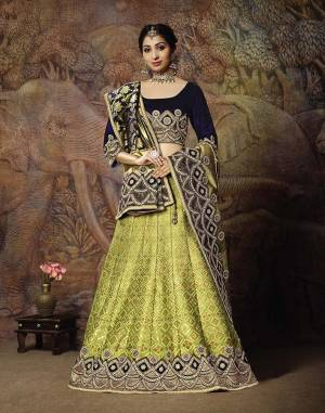 You Will Definitely Earn Lots Of Compliments In This Rich Silk Based Designer Lehenga Choli. Its Blouse Is In Navy Blue Color Paired With Light Green Colored Lehenga And Navy Blue Colored Dupatta. It Is Beautified With Bold Weave And Subtle Embroidery Over The Blouse. Buy This Silk Based Lehenga Choli Now.