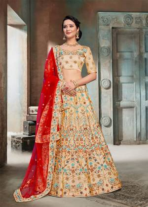 Evergreen Traditional Combination Is Here With This Heavy Designer Lehenga Choli In Beige Color Paired With Contrasting Red Colored Dupatta. This Lehenga Choli Is Fabricated On Nylon Silk Beautified With Heavy Embroidery Paired With Net Fabricated Dupatta. Buy Now.