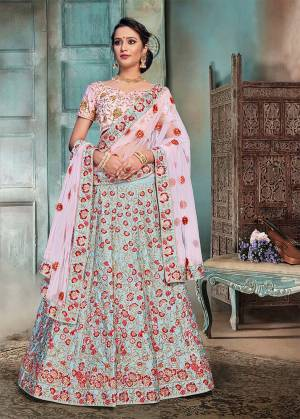 Summer Is All About Pastels. So Grab This Heavy Embroidered Designer Lehenga Choli In Baby Pink Colored Blouse And Dupatta Paired With Contrasting Aqua Blue Colored Lehenga. This Lehenga Choli Is Fabricated On Nylon Satin Paired With Net Fabricated Dupatta.