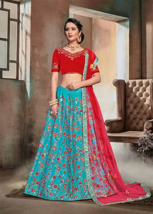 Catch All The Limelight Wearing This Heavy Designer Lehenga Choli In Red Colored Blouse And Dupatta Paired With Contrasting Blue Colored Lehenga. This Heavy Embroidered Lehnega Choli Is Fabricated On Nylon Satin Paired With Net Fabricated Dupatta.