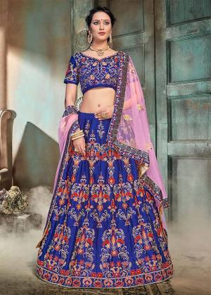 Bright And Visually Appealing Color Is Here With This Heavy Designer Lehenga Choli In Riyal Blue Color Paired With Contrasting Powder Pink Colored Dupatta. This Lehenga And Choli Are Fabricated On Nylon Satin Paired With Net Fabricated Dupatta. Buy This Now.