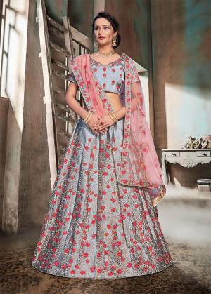 Flaunt Your Rich And Elegant Taste Wearing This Heavy Designer Lehenga Choli In Grey Color Paired With Contrasting Baby Pink Colored Dupatta. This Heavy Embroidered Lehenga Choli Is Fabricated On Nylon Satin Paired With Net Fabricated Dupatta. Buy This Now.