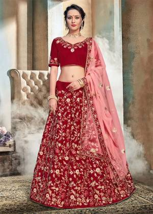 Get Ready For The Upcoming Wedding Season With This Heavy Embroidered Lehenga Choli In Maroon Color Paired With Contrasting Pink Colored Dupatta. Its Blouse And Lehenga Are Fabricated On Nylon Satin Paired With Net Fabricated Dupatta. Buy This Attractive Looking Lehenga Choli Now.