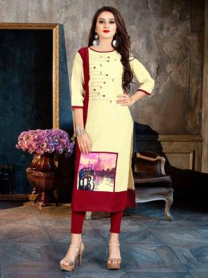 Beat The Heat This Summer With This Readymade Light Weight Kurti Fabricated On Rayon. This Kurti Is Beautified With Printed Patch And Buttons. Buy Now.