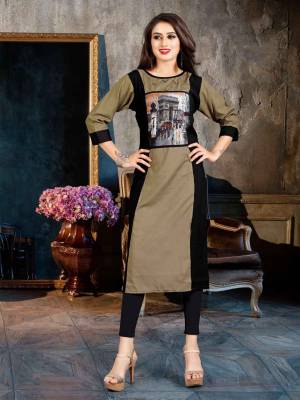 Grab This Beautiful Readymade Kurti For Your Casual Or Semi-Casual Wear, This Kurti Is Fabricated On Rayon Beautified With Printed Patch And Buttons. Buy Now.