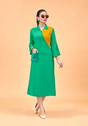 For Your Semi-Casual Wear, Grab This Designer Readymade Kurti In Green And Yellow Color Fabricated On Rayon. This Elegant Looking Plain Kurti Has Beautiful Pattern Giving It A Trendy Look. Buy This Kurti Now.