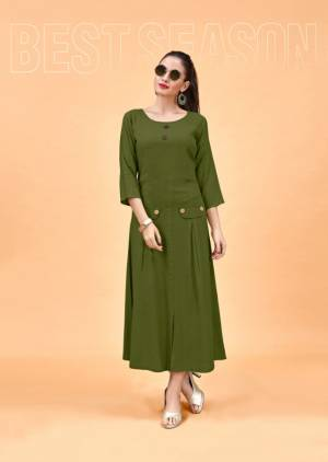 Trending And The Most Loved Color Nowdays Is Here With This Designer Readymade Kurti In Olive Green Color Fabricated On Rayon. It Is Available In All Regular Sizes, Choose As Per Your Fit And Comfort.