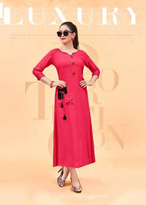 Shine Bright Wearing This Designer Reeadymade Kurti In Dark Pink Color Fabricated On Rayon. This Pretty Kurti Can Be Paired With Same Or Black Colored Leggings Or Pants. Its Fabric Also Ensures Superb Comfort All Day Long.