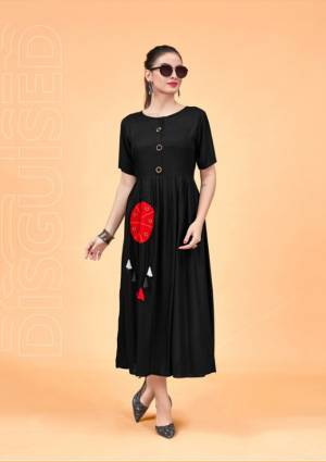 For A Bold And Beautiful Look, Grab This Designer Readymade Kurti In Black Color Fabricated On Rayon. Its Bold Black Color And Pretty Pattern Will Earn You Lots Of Compliments From Onlookers.