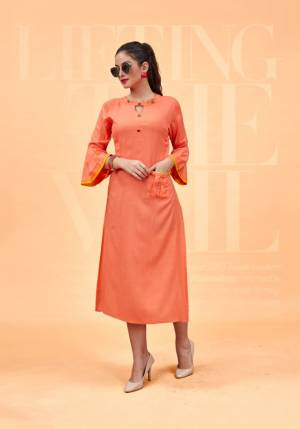 Add This Beautiful Designer Readymade Kurti To Your Wardrobe In Orange Color Fabricated On Rayon. This Straight Kurti With High Neck Pattern Gives A Rich Look To Your Personality. Buy Now.