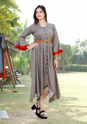 Here Is Another Readymade Kurti With High Low Pattern In Grey Color. This Kurti Is Fabricated On Rayon Beautified With Polka Dots Prints All Over It With Contrasting Red Color.