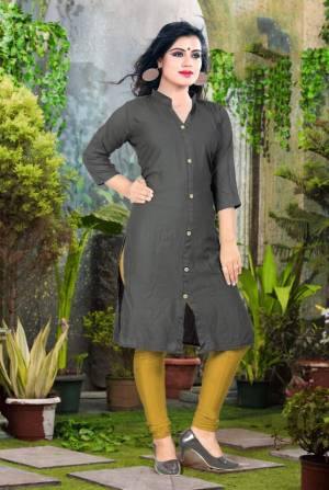 Add Some Casuals With This Plain Readymade Kurti In Dark Grey Color Fabricated On Cotton. This Kurti Is Light Weight, Soft Towards Skin, Durable And Also Available In All Regular Sizes, Buy This Simple Kurti Now.