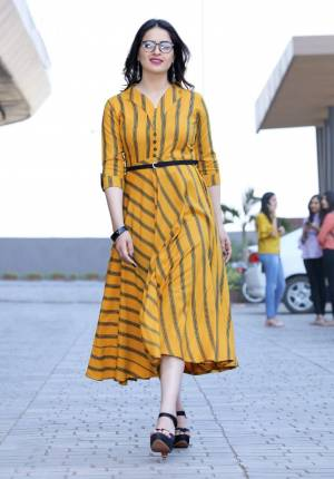 Go With The Seasons Trend With This Deisgner Readymade Kurti In Yellow Color Fabricated On Rayon Beautified With Lining Prints All Over It. This Can Be Paired With Any Kind Of Bottom And No Bottom As A Maxi. This Kurti Is Available In All Regular Sizes. Buy Now.