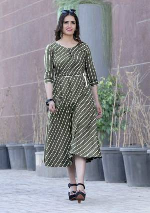 Another Formal and Rich Looking Readymade Kurti Is Here In Dark Olive Green Color Fabricated On Rayon. It IS Beautified With Lining Prints All Over It. Buy Now.