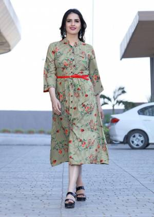 Go Floral With This Designer Reaydmade Kurti In Light Green Color Fabricated On Rayon Beautified With Floral Prints All Over. It Is Light In Weight And Easy To Carry All Day Long.