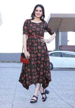 Another Pretty Floral Printed Readymade Kurti Is Here In Dark Brown Color Fabricated On Rayon. It Is Beautified With Contrasting Floral Prints All Over, Buy Now.